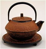 Copper Colored Teapot with Trivet